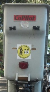 "A bike's child seat is the perfect place to put a ""Check for Bikes"" bumper sticker!"